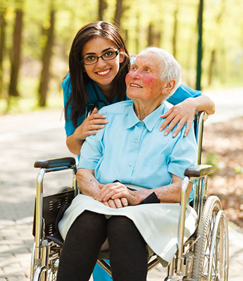 nurse and older lady in wheelchair